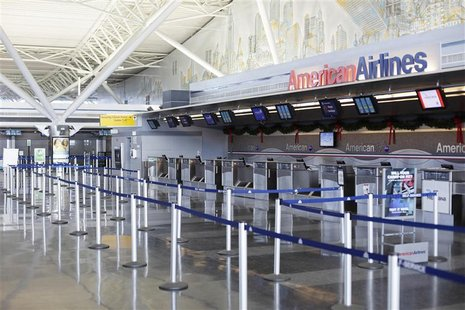 An American Airlines counter stands empty at John F Kennedy International Airport in New York