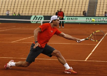 Spain's Rafael Nadal returns a ball during a training session for the upcoming Davis Cup final in Seville