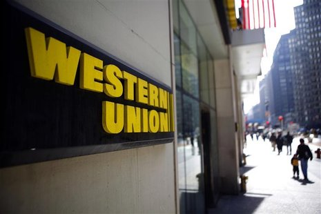 People walk outside a Western Union branch in New York
