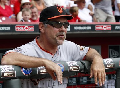 Giants' manager Bochy watches his teams play against the Reds during the second inning of play in their National League MLB baseball game at