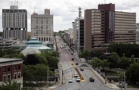 Traffic goes by in downtown Flint, in Michigan