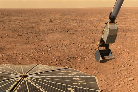 NASA?s Phoenix Mars Lander?s solar panel and the lander?s Robotic Arm with a sample in the scoop are seen