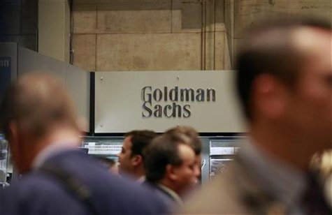 Traders work on the floor of the New York Stock Exchange near the Goldman Sachs stall