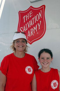 Cocoa, FL, September 10, 2004--Karen Henderson and granddaughter Chelsea Wise pose for the camera. They are helping serve meals for the Salvation Army at Byrd Plaza to residents affected by Hurricane Frances. FEMA Photo/Jocelyn Augustino By Jocelyn Augustino (This image is from the FEMA Photo Library.) [Public domain], via Wikimedia Commons