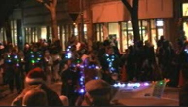 Parade of Lights parade stepping off in Downtown Holland.