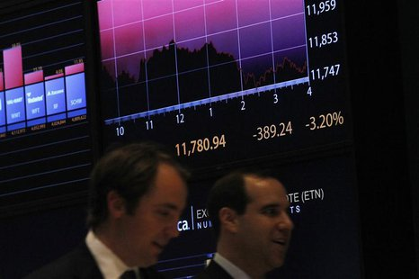 A screen shows the Dow Jones industrial average on the floor of the New York Stock Exchange