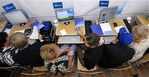 "Students and elderly people participate in the ""Generation ON-LINE"" program at a computer-equipped classroom of gymnasium number one in Vlad"