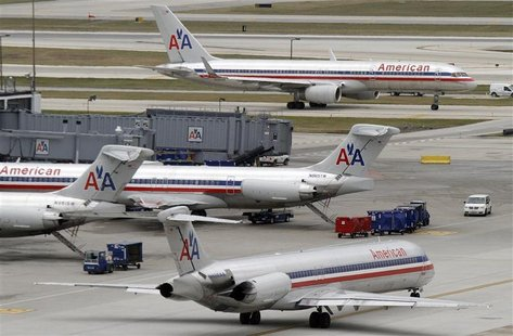 American Airlines planes sit at their gates while others taxi for arrival and departure at O'Hare International airport in Chicago