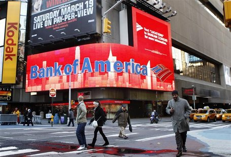 Pedestrians walk past a Bank of America sign on a building in Times Square in New York