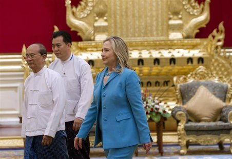 U.S. Secretary of State Hillary Clinton walks with Myanmar's President Thein Sein at the President's Office in Naypyitaw