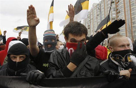 "Russia's ultra-nationalists gesture during a ""Russian March"" demonstration on National Unity Day in Moscow"