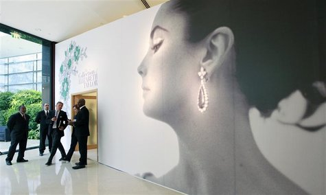 Visitors walk past the entrance of Christie's auction of The Collection of Elizabeth Taylor in Dubai