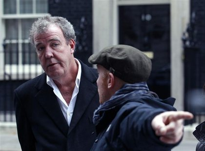 BBC automobile program Top Gear presenter Clarkson speaks with a member of his crew outside 10 Downing Street in London