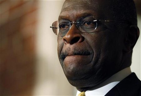 Republican presidential candidate and businessman Herman Cain listens to a question from a reporter during a news conference in Manchester,