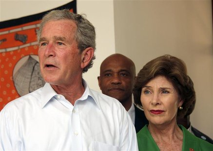 George W. Bush and Laura Bush arrive at Mnazi Mmoja Hospital to see the government efforts in the prevention of transmission of HIV/AIDS in