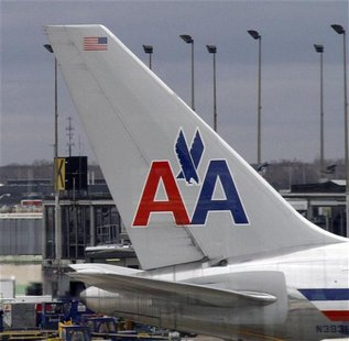 An American Airlines plane sits at its gate at O'Hare International airport in Chicago