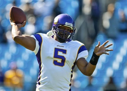 Minnesota Vikings quarterback Donovan McNabb warms up before playing the Carolina Panthers during an NFL football game in Charlotte