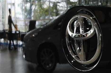 A visitor is reflected on a Toyota car at the company's showroom in Tokyo