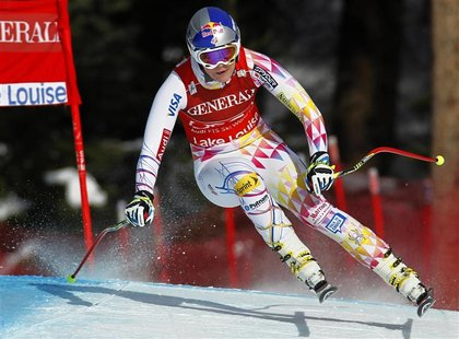 Lindsey Vonn of the U.S. turns past a gate while on her way to winning the Women's World Cup downhill alpine skiing race in Lake Louise