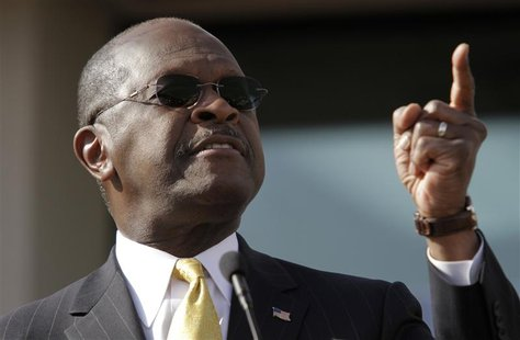 "Herman Cain gestures as he announces that he is ""suspending"" his Republican presidential campaign at his Georgia campaign headquarters in At"