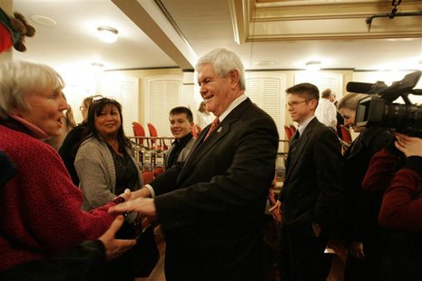 Republican Presidential candidate Gingrich shakes hands with a supporter in Newberry
