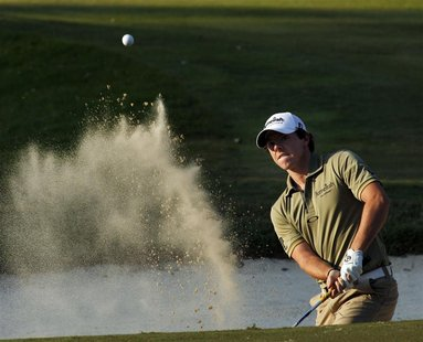 Rory Mcllroy of Northern Ireland hits from a bunker on the 18th green after winning the Hong Kong Open golf tournament