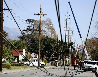 Workers repair power lines downed by heavy winds at Temple City in California