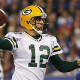 Green Bay Packers quarterback Rodgers throws a touchdown pass against the New York Giants in the first quarter during their NFL football gam