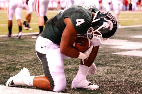 Michigan State Running Back Edwin Baker kneels after scoring a touchdown in the Spartans 42-39 loss to the Wisconsin Badgers in the Big Ten Championship.