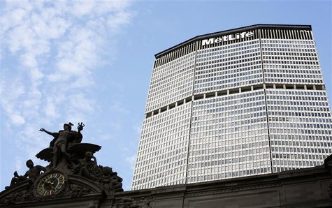 Statue stands atop Grand Central Station in front of the MetLife building in New York