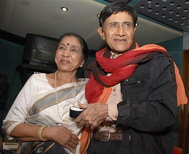 Veteran Bollywood actor Anand and singer Bhosle pose in Mumbai