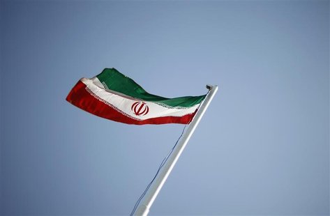 An Iranian national flag flutters during the opening ceremony of the 16th International Oil, Gas & Petrochemical Exhibition (IOGPE) in Tehra