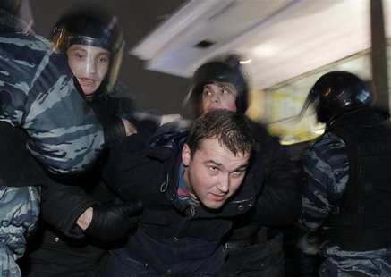Russian police detain a participant during an opposition protest in central Moscow