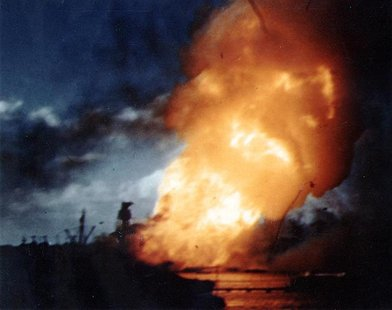 The USS Arizona is seen ablaze, immediately following the explosion of its forward magazines after the Japanese attack in Pearl Harbor, Hawa