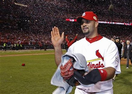 St. Louis Cardinals first baseman Pujols reacts on the field after the Cardinals defeated the Texas Rangers to win MLB's World Series baseba