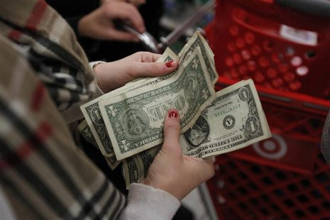 "A customer counts her money while waiting in line to check out at a Target store on the shopping day dubbed ""Black Friday"" in Torrington"