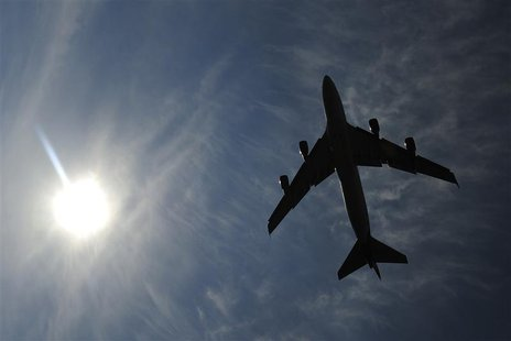 A jumbo jet takes off shortly after midday from Heathrow Airport in west London