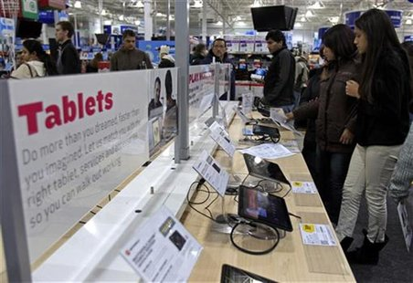 "Shoppers look at tablet computers at a Best Buy Store on the shopping day dubbed ""Black Friday"" in Framingham"