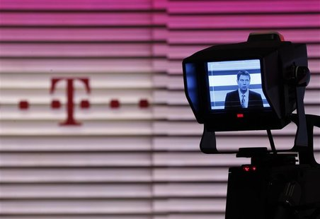 CEO of Deutsche Telekom Obermann is seen on a camera display during the annual news conference in Bonn