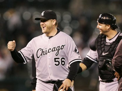 Chicago White Sox pitcher Buehrle and catcher Pierzynski celebrate beating the Oakland Athletics in their MLB American League baseball game