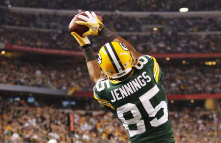 Green Bay Packers wide receiver Greg Jennings (85) catches a fourth quarter touchdown against the Pittsburgh Steelers during the NFL's Super Bowl XLV football game in Arlington, Texas, February 6, 2011. REUTERS/Mike Stone (UNITED STATES - Tags: SPORT FOOTBALL)