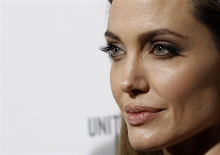 "Jolie poses at the premiere of ""In the Land of Blood and Honey"" in Los Angeles."