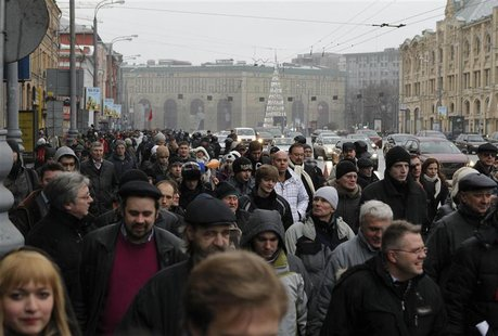 People walk in the city centre to attend a sanctioned rally in Bolotnaya square to protest against violations at the parliamentary elections