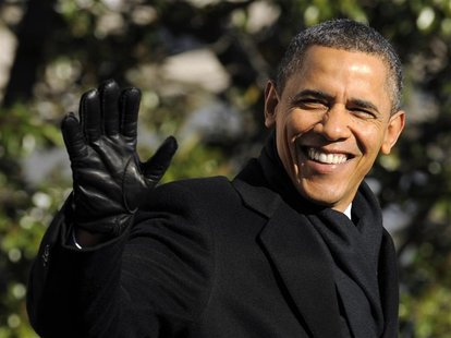 US President Obama waves to the press while walking on the South Lawn in Washington DC