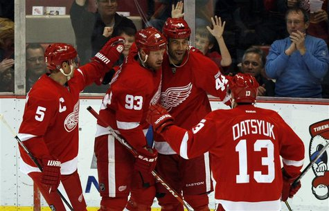 Detroit Red Wings' Bertuzzi celebrates with his teammates after he scored against the Winnipeg Jets during the first period of their NHL hoc