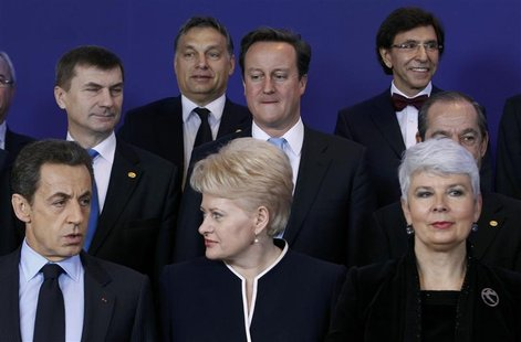 Hungary's Prime Minister Orban and Britain's Prime Minister Cameron attend a EU leaders summit in Brussels