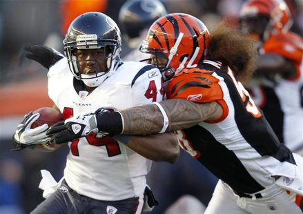 Texans Tate is tackled by Bengals Maualuga in Cincinnati, Ohio