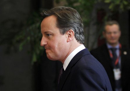 Britain's Prime Minister Cameron leaves the European Council headquarters after a night of negotiations at a European Union summit in Brusse