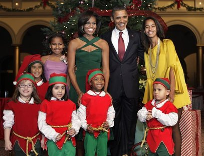 "U.S. President Barack Obama and family pose with children, dressed as elves, at the ""Christmas in Washington"" celebration in Washington"
