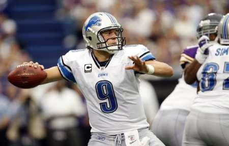 Detroit Lions quarterback Matthew Stafford throws against the Minnesota Vikings during the fourth quarter of their NFC football game in Minneapolis September 25, 2011. Detroit won the game in overtime. REUTERS/Eric Miller (UNITED STATES - Tags: SPORT FOOTBALL)